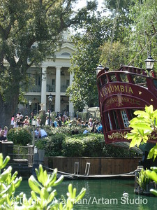 view from Pirate's Lair of the Haunted Mansion facade and aft of Columbia