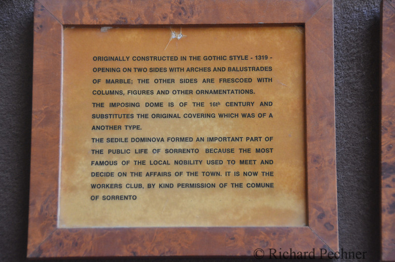 plaque recounting history of building