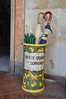 "umbrella holder with ""Societa Operaia, Sorrento"" painted on outside"
