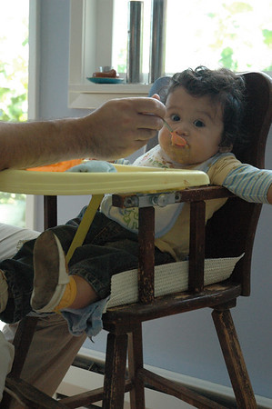 Jaden making a big mess in Luke's old high chair.
