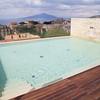 Sorrento: Hotel Plaza: Sky pool on sixth floor of hotel, toward Vesuvius