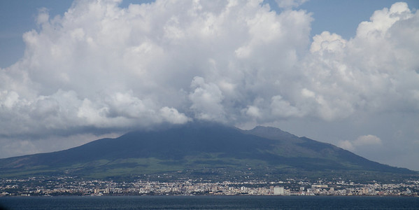 Vesuvius with the four towns that are densely populated at its feet.  This is a precarious area to live because the volcano's eruptions have destroyed many towns previously.