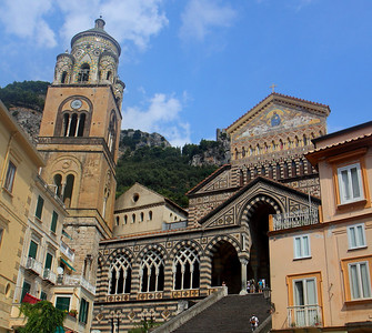 The Cathedral in Amalfi.  The building on the left, with the bell tower, was built around 1200 AD.  The newer building on the right was built a couple hundred years later in an arab-romanesque style.