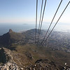 The cable car is about to reach the top of Table Mtn.  Capetown on the right, Robben island in the distance.