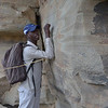 Guide Elijah demonstrated how the small Bushman Shamen <br /> could steady their arms for painting on the vertical surface of the sandstone.
