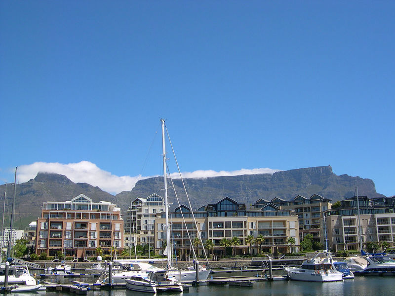 "Table Mountain with the clouds (called the ""tablecloth"") starting to cover the mountain again."