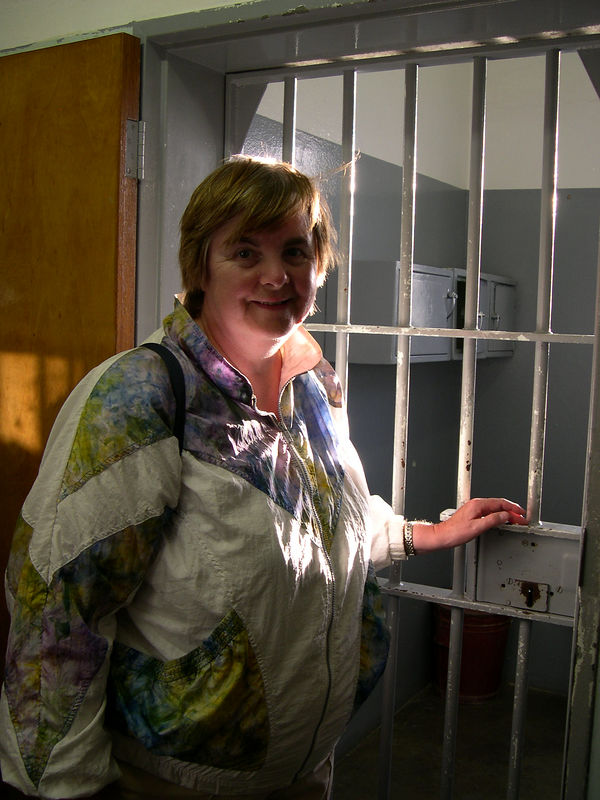 Susan at the entrance to Nelson Mandela's cell.