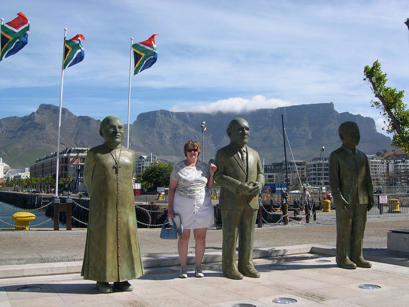 Susan at the memorial for the Nobel Lauriates in Capetown.  The statues are slightly larger than life size, except for the heads.  From the left, there is Bishop Desmond Tutu, President F. W. de Klerk, and Nelson Mandela.