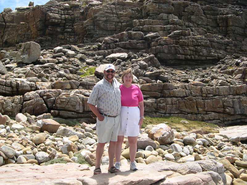 Dick and Susan, with the rocks of the Cape of Good Hope in the background.