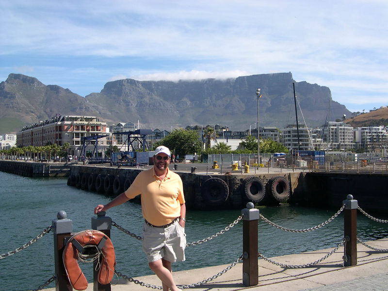 Dick at the Capetown waterfront with Table Mountain in the background.