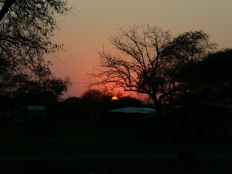 Sunset over Satara camp in the park.