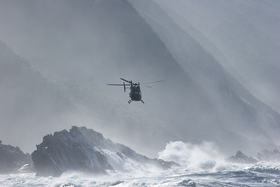 South African navy chopper above the surf. Storms River Mouth, Tsitsikamma National Park, South Africa.