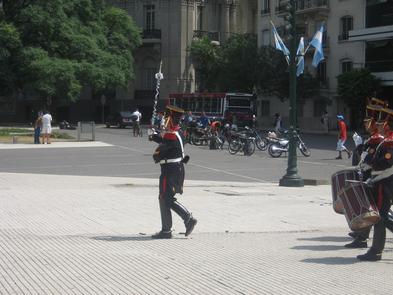 What pageantry! A band of Argentine grenadiers from the presidential guard crossing a plaza to take part in a ceremony at the monument to San Martín.