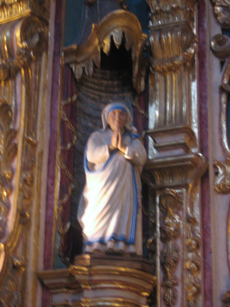 Detail of interior of Nuestra Señora del Pilar church in the Recoleta neighborhood. Mother Teresa is given a statue among those of saints.