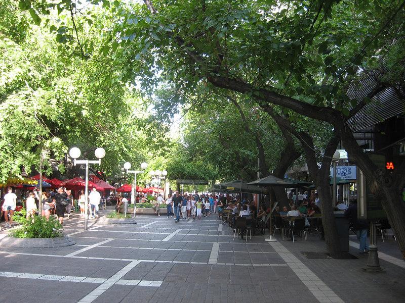 Pedestrian walkway with sidewalk cafés under the trees in Mendoza.