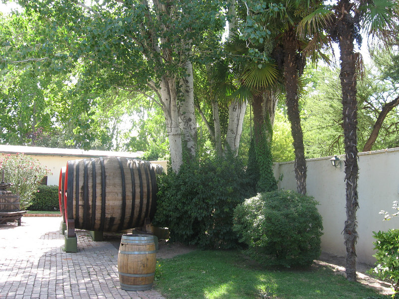 Cask and courtyard at LaGarde winery in Luján de Cuyo. A beautifully landscaped spot.