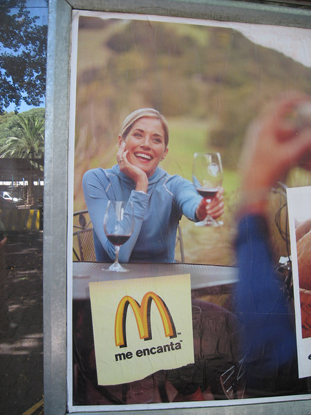 Part of McDonald's billboard showing that wine is served in their cafés here.