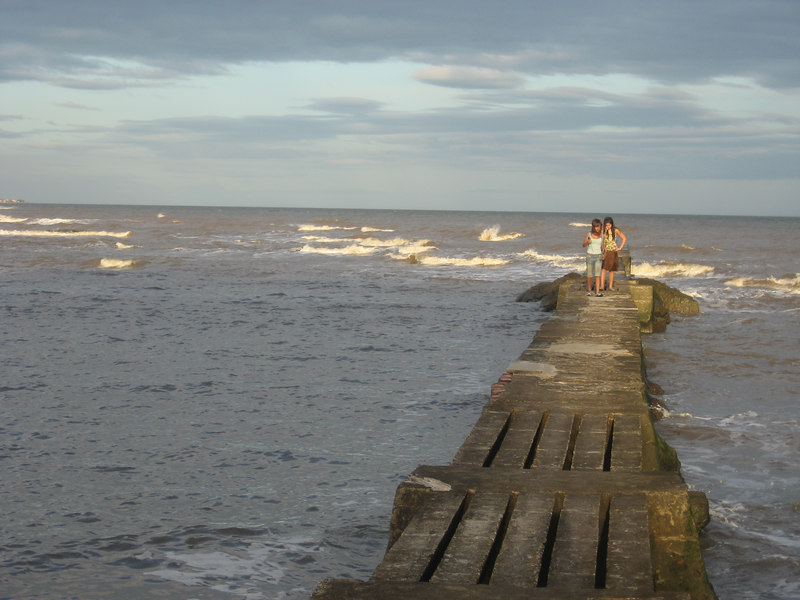 Two young girls on the fishing pier near our hotel. The Rio de la Plata is tidal this far from the ocean and has waves.