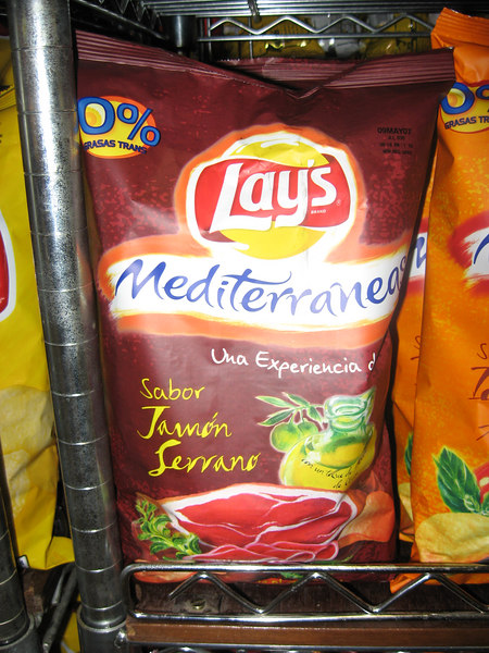 "Yes, this is a package of ham-flavored potato chips for sale in a supermarket. As the package says, ""A taste experience!"""