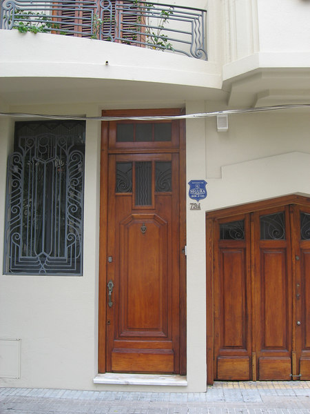 Wonderful wood and wrought iron in these doors, windows and balcony.