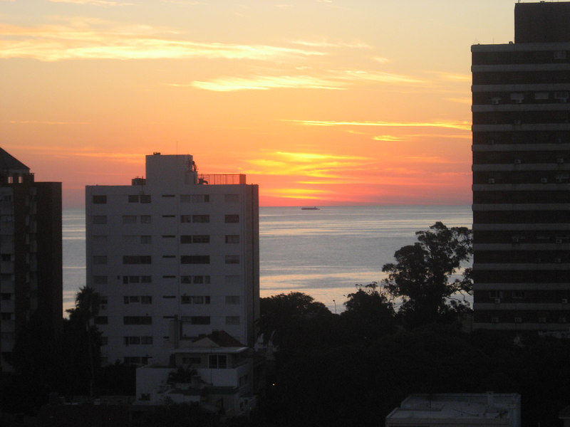 Sunset over the Rio de la Plata with ocean-going vessel from the roof-deck of our hotel.