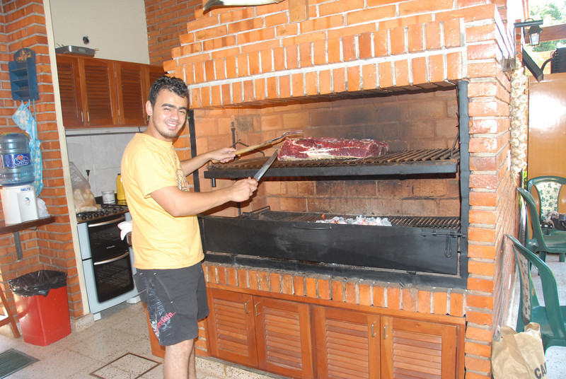Grilling at Trond's house. Beef is plentiful, cheap and, by our standards, tough. Outdoor grills such as this are almost standard fare among middle-class Paraguayans.