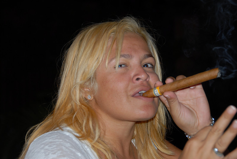 A Paraguay beauty enjoys a fine Cuban cigar.