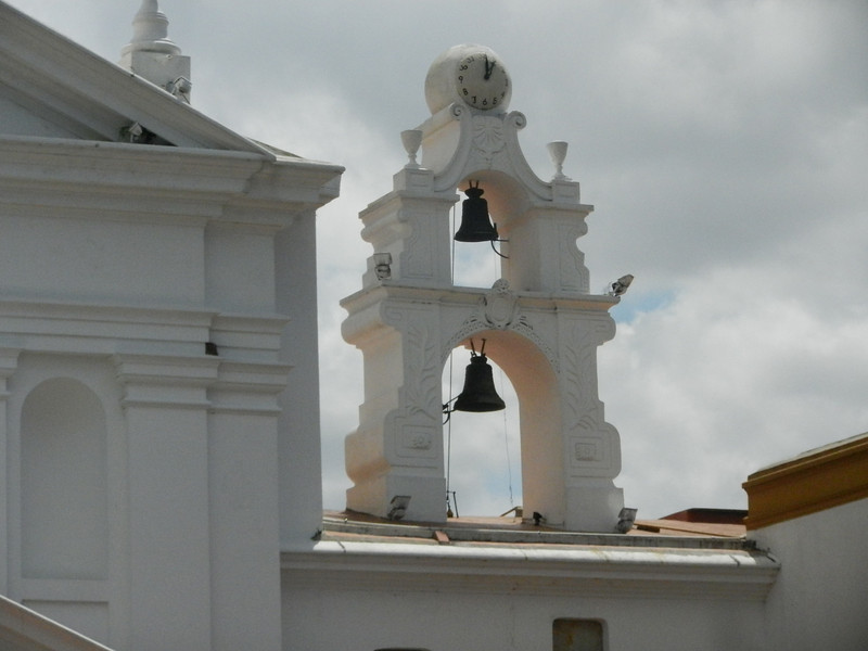 The bell tower of the church just outside.