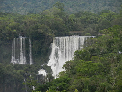 First sight of the falls, with the Argentinian walkway visible through the trees.