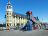The waterfront has been developed with a promenade and a children's playground