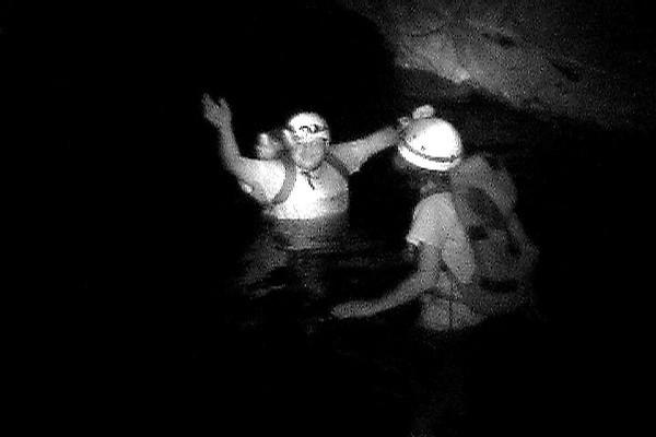 Celia & Barry waiste deep inside cave