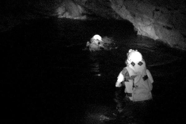 Celia & Barry swimming inside cave