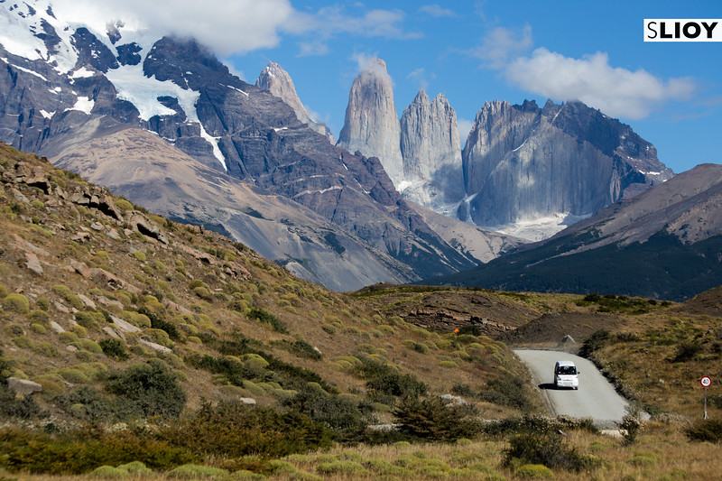 Driving a rental car out of Torres del Paine National Park in Chilean Patagonia.