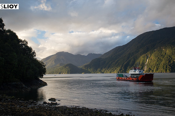 A ferry boat departs Caleta Gonzalo in Chilean Patagonia's Parque Pumalin.