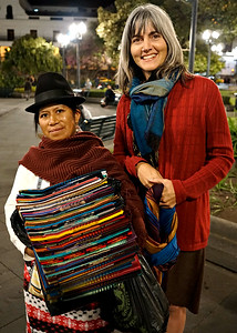 Buying scarves in the Quito Plaza, Quito