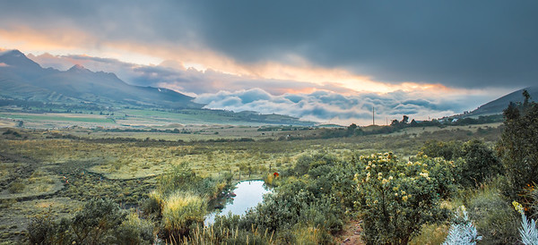 Clouds rolling in along the valley at Cotopaxi Volcano, Ecuador
