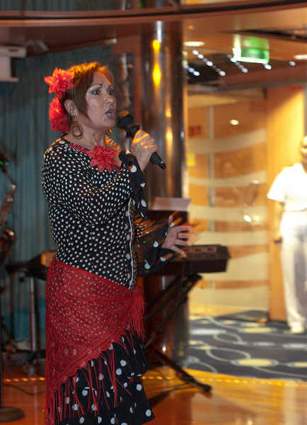 Another staff member signs and performs the flamenco.