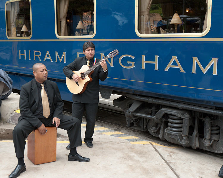 "We were entertained by a trio of musicians on the train ride. Here we have one of the guitarists and the ""drummer""."