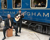 """We were entertained by a trio of musicians on the train ride. Here we have one of the guitarists and the """"drummer""""."""