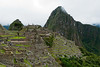 More or less your first view of Machu Picchu, which appears out of nowhere as you climb a set of stairs.