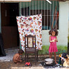 Young girl wahing clothes outside her house, Cortes, Pernamucco, Brasil