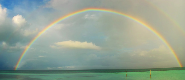 OK...poor stiitching as very new to photography, but only time I have seen a FULL rainbow!    Coco Caye, Belize
