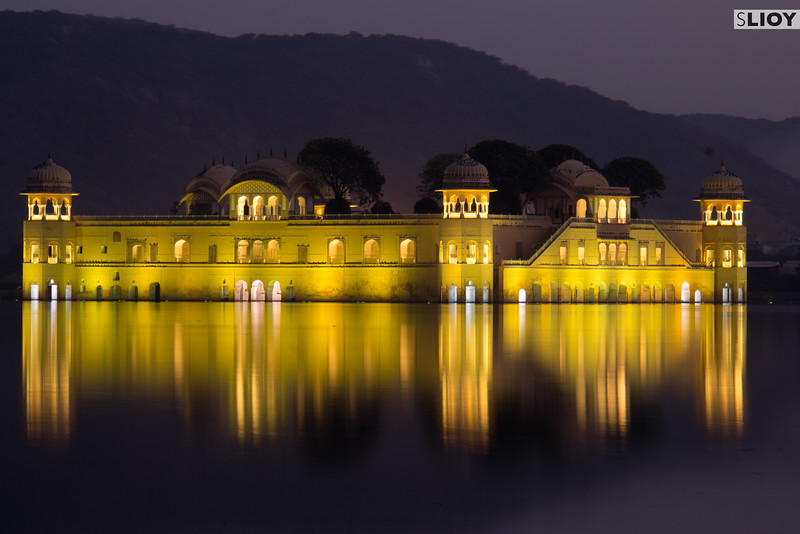 Night falls over the water palace in Jaipur.