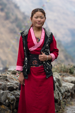 A local Tamang woman on the pathways of Gatlang village along the Tamang Heritage Trail in Nepal.