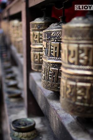 Prayer Wheels inside a Patan Buddhist temple.