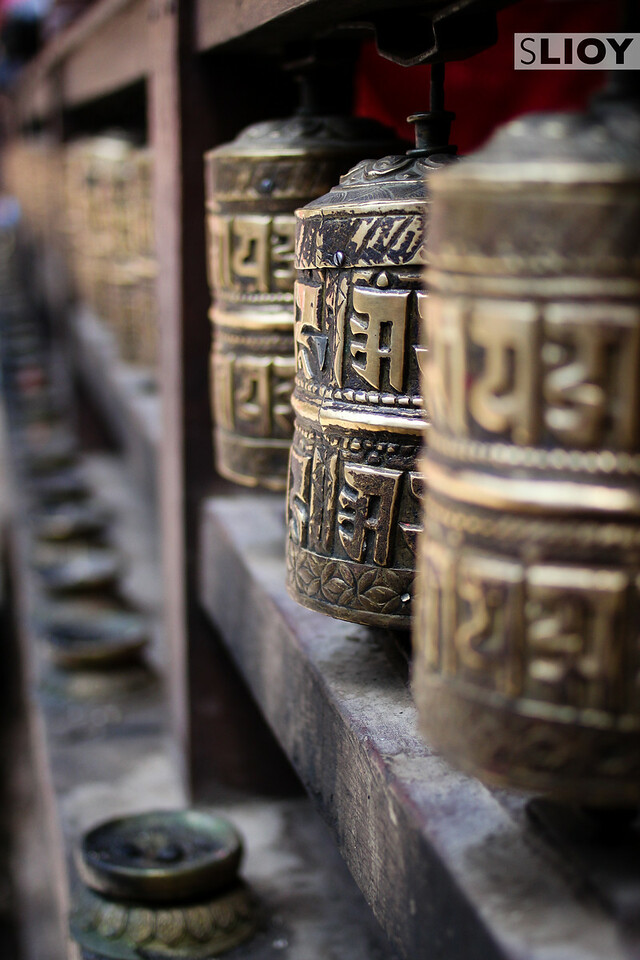 Prayer Wheels inside a Patan Buddhist temple.