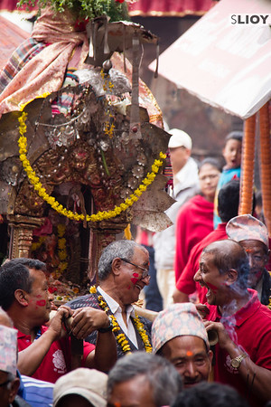 Two local men share a laugh during a break in the Bisket Jatra action.