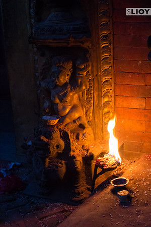 Night offerings to a statue in Bhaktapur Durbar Square.