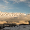 Panorama of clouds covering snowy mountain peaks along the Tamang Heritage Trail in Nepal.