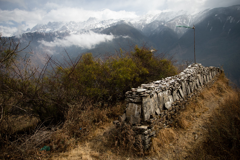 Mani walls along the descent from Thume village along the Tamang Heritage Trail in Nepal.